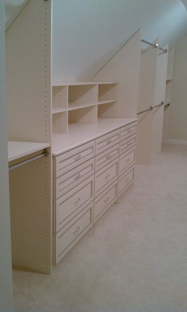 slanted ceiling storage wall, or maybe for an attic space- yea!!! our attic can be a nice place to store our excess clothings!