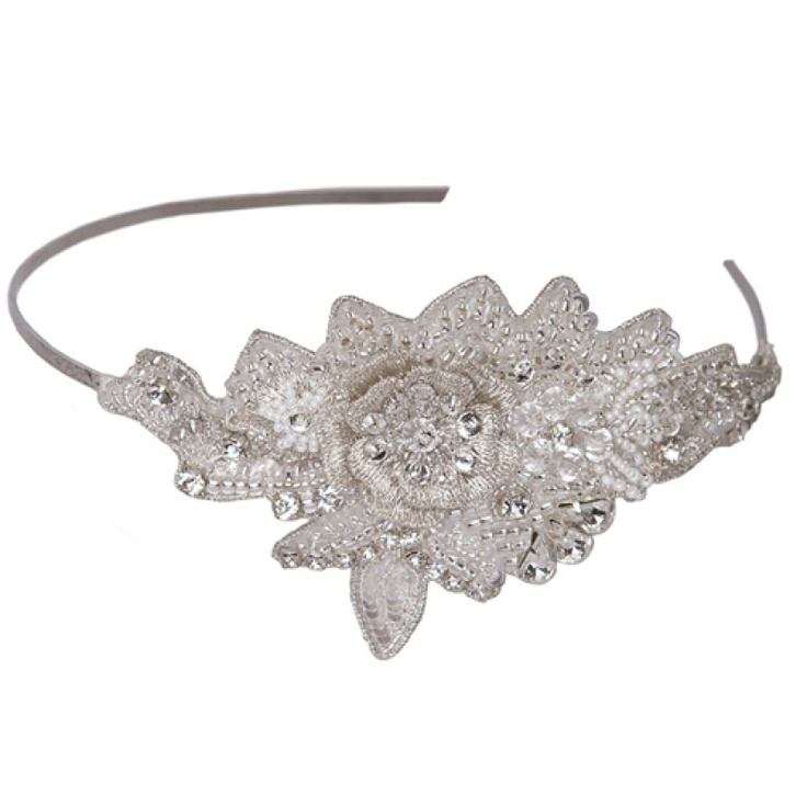 Elder - An exquisite wedding headpiece featuring a hand embroidered band completed with tiny seed beads and stunning silver sequence with crystal highlights. A Rainbow Club best seller, completed with an ivory ribbon wrapped flexible band. £125.00