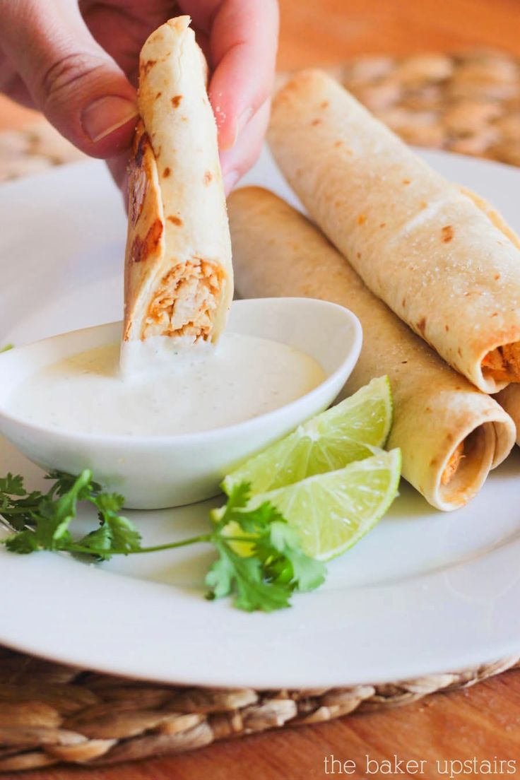 Baked honey lime chicken taquitos - so flavorful and so easy to make! www.thebakerupstairs.com