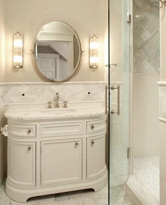 Simple Fixtures Glass Sconces And Marble Tile Combine For A Timeless Bathroom Space The