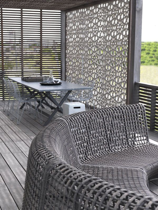 The patterns in this porch screen and matching outdoor furniture is great. I can't tell the material, but love how the color unifies them. It looks like lace.