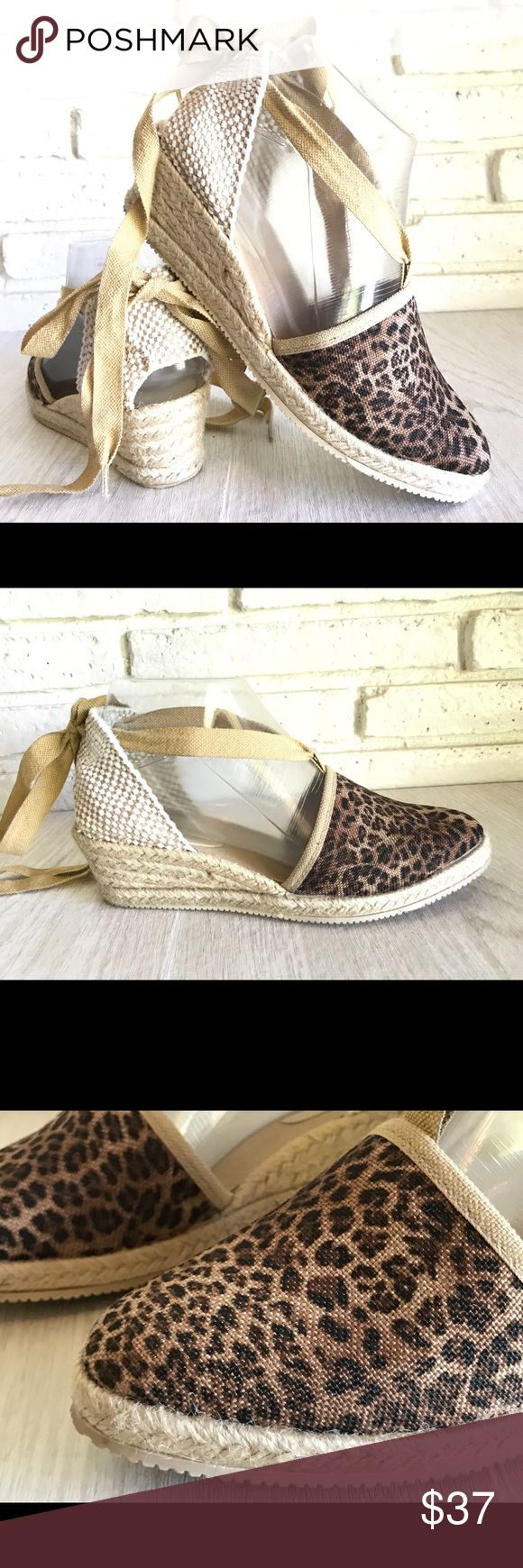 """Leopard Print Espadrille Wedge Sandals Size 7 ILSE JACOBSEN Women's Sand Nomad 54 Espadrille Sandal Size 7  Canvas  Rubber sole  Heel measures approximately 2""""  Platform measures approximately 0.50""""  Mixed-texture espadrille with closed toe and wraparound ankle strap  Jute-wrapped wedge  In excellent condition  Leopard print canvas espadrilles. 135 cm cotton lace to drape around the leg. The classic raffia wedge sole comes with an rubber outsole. Ilse Jacobsen Shoes Espadrilles"""