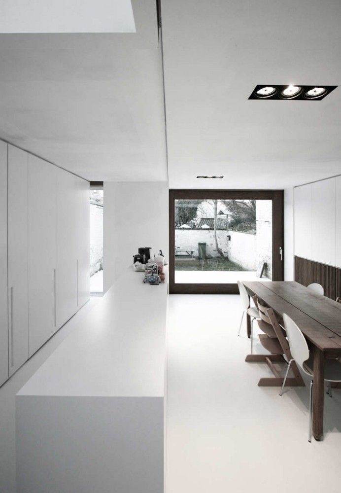 White kitchen by Belgian architects Graux & Baeyens.