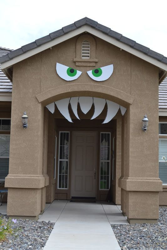 turn your housefront door into a monster simple and cheap halloween craft decoration idea