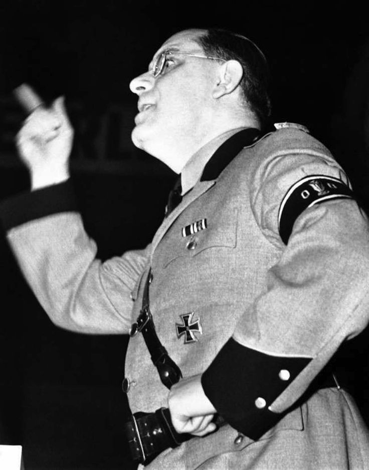 At the meeting of the German American bund held in Madison Square Garden, New York on Feb. 20, 1939,Fritz Kuhn, national leader of the Bund, uttered imprecations against the Jews. He was the concluding speaker in a Bund programme which was marked by violence, despite a police guard of hundreds. Fritz Kuhn, in full uniform of a storm trooper, delivering his bitter attack on the Jews, at the meeting of the German American Bund held in Madison Square Garden, New York on Feb. 20, 1939.