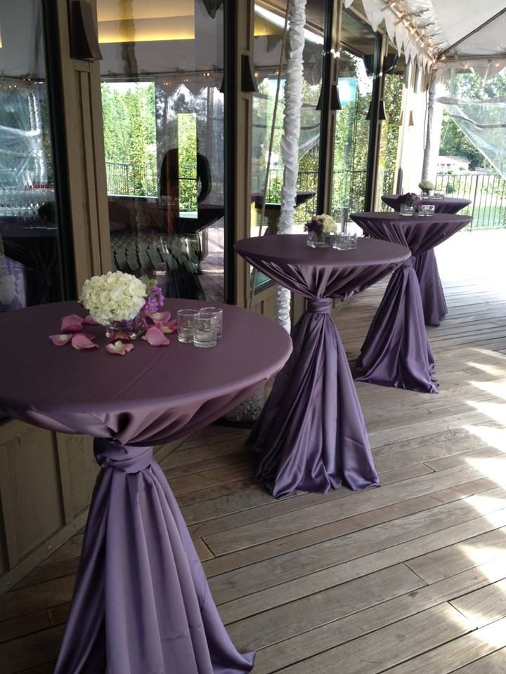 Beautiful bistro tables done by Vibrant Table Catering & Events! The Victorian Lilac Lamour table cloths complement the scenery perfect!