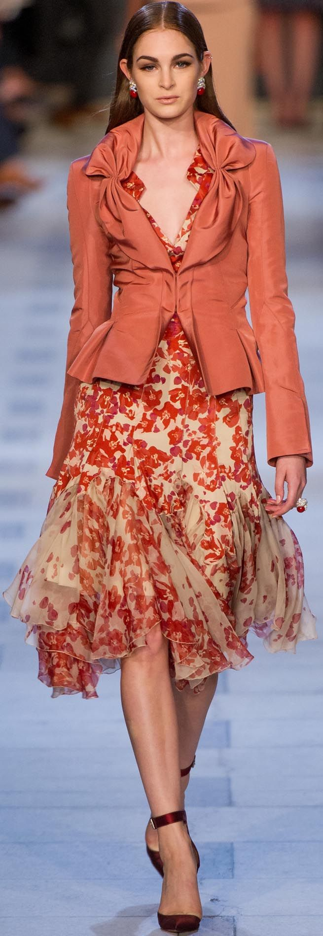 Tones of coral and russet on butterscotch. Chiffon floral dress with gores and handkerchief hemline. Fitted jacket with peplum and gathered detail on collar. Zac Posen 2013 Ready-To-Wear Collection.