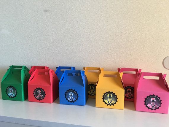 Power rangers samurai party favor boxes Comes in orders of 10 2 yellow 2 blue 2 red 2 green 2 pink Unless other colors specified !!!!!❗️Please be aware that these boxes are not designed for a heavy amount of times. They can fit chip bags a good amount of candy anything light. Heavy items like juice boxes or water bottles will cause the bottom flaps to open !!!!❗️ This listing is for first class 4-6 day mail If needed sooner there is a priority 2 day option for shipping after the 1-2 we...
