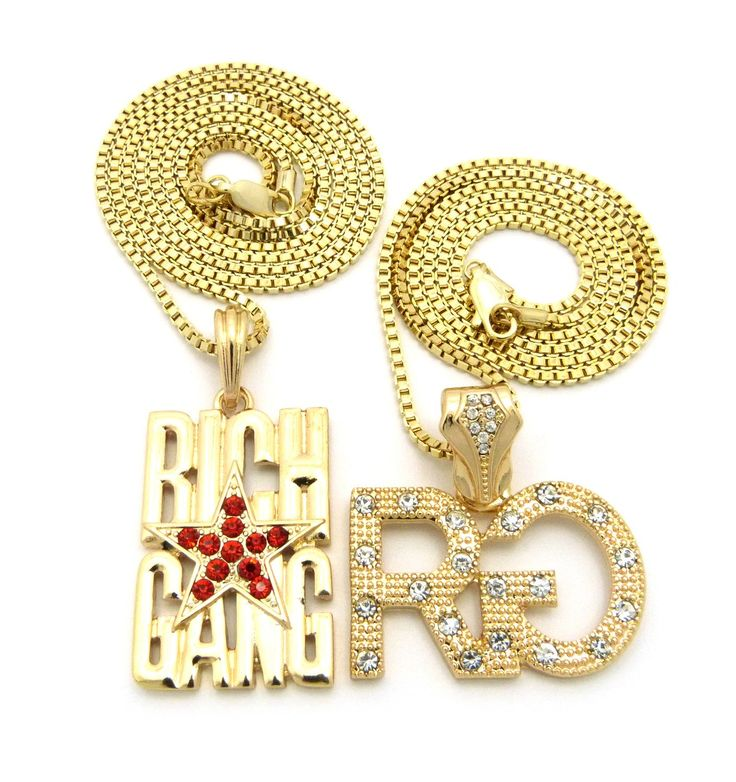 "Gold-Tone Iced Out Rich Gang Star RG Pendant Box Chain Hip Hop 2 Necklace Set RC896G. Gold-Tone Iced Out Rich Gang Star RG Pendant Box Chain Hip Hop 2 Necklace Set. Size of RG: 1.5"" x 1.5"", 2mm 24"" Box Chain. Size of Rich Gang: 1.0"" x 2.0"", 2mm 30"" Box Chain. Imitation Gold Tone Plated."