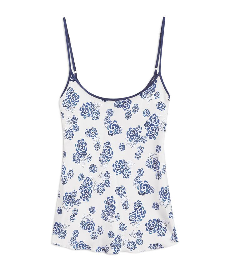 Ditsy Lotus Silk Camisole £154 - Our White, Blue Floral Silk Camisole is one of our most versatile pieces. The silk cami is bias cut which allows the fabric to stretch and cling at the same time. A flattering centre back seam follows the feminine curve of the waist and a delicate pin hem gives a fluted finish at the hip. The scoop neck and delicate, adjustable straps are in indigo blue silk to match other garments in the Lotus collection.