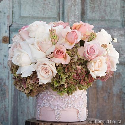 …antiqued hydrangeas, blush roses and tuberoses spill from this gorgeous lace covered box…one of the most feminine arrangements I've ever seen…beautiful!    (image via Enchanted Florist)