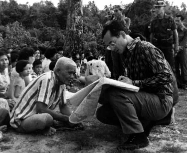 Picture shows King Bhumibol Adulyadej speaking to an old villager. Soul of A Nation - The Royal Family of Thailand is a unique film illustrating the life and problems of the present King and his family.