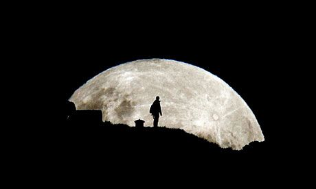 """Cosmic closeup ... a supermoon seen from Mount Eden, Auckland, New Zealand over the weekend. Photograph: Simon Runting/Rex Features  Photographers took spectacular shots of this year's """"supermoon"""", the visual spectacle that occurs once a year when the full moon is closest to the Earth. Pictures showed the giant moon dwarfing observers and looming over hillsides as if it was approaching the Earth in a science-fiction scenario."""