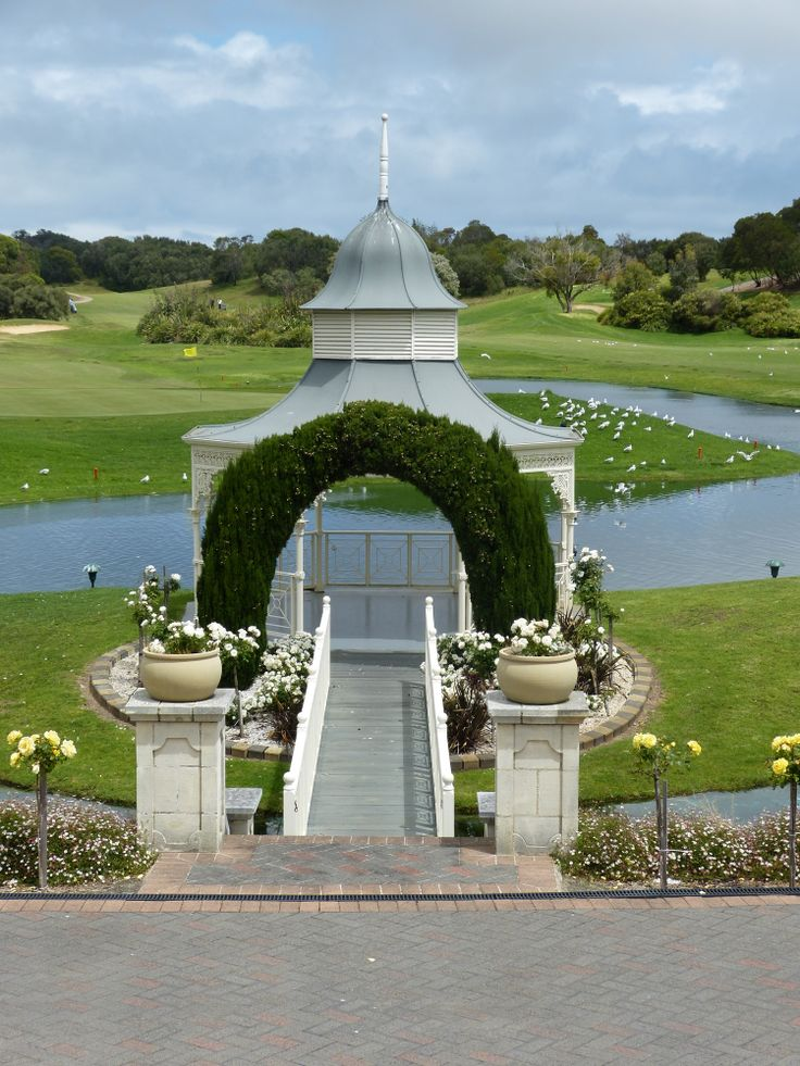 Eagle Ridge Golf Course - Mornington Peninsula - the bridal couple get married between the pillars and then walk down to sign the marriage certificate in the gazebo