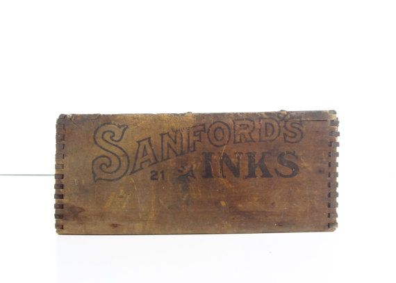Wonderful vintage wood crate. This smaller sized and very old crate was made for Sanfords premium fluid ink by Sanford Mfg. Co., Chicago, New York. Great rustic/industrial look with the gorgeous advertising in black ink on all four sides in a great old fashioned style. This has dovetail joints. This box has wonderful heavy distressing and overall a nice worn aged patina with lots of dark staining, scratches, etc. It is in overall good and solid condition, just the obvious wear from age a...
