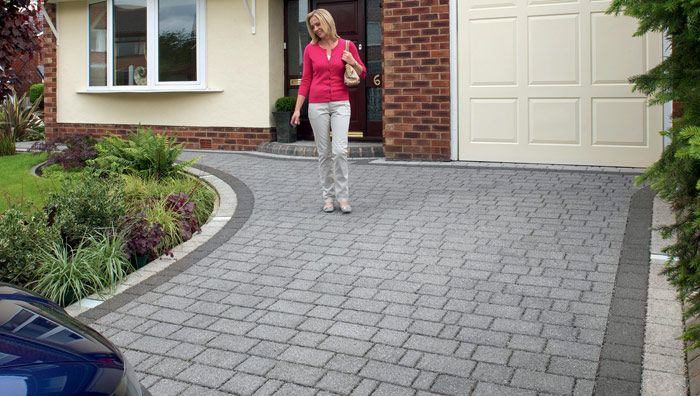 An attractive granite look driveway with a lower carbon footprint than granite. Includes a drainage system which doesn't require mebranes or soakaways.