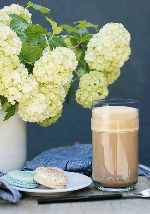 Nothing says quiet moment to yourself quite like fresh flowers, an indulgent sweet treat, and a bold coffee creation served in the VertuoLine Recipe Set from Nespresso.