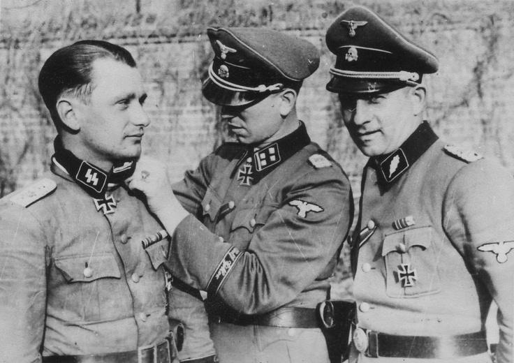 Hauptsturmfuhrer Waffen SS Hermann Weiser receives his ...