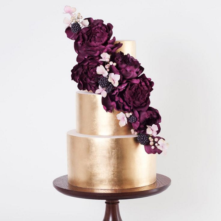 Elegance reigns supreme when you combine a gold metallic cake with marsala-hued sugar flowers.