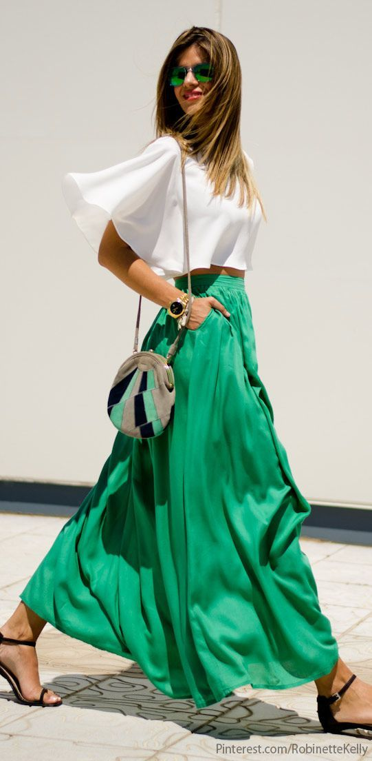 white top and green skirt