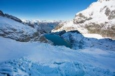 A twist of glaciers converge on an alpine lake in the east of the Darran Mountains, New Zealand.