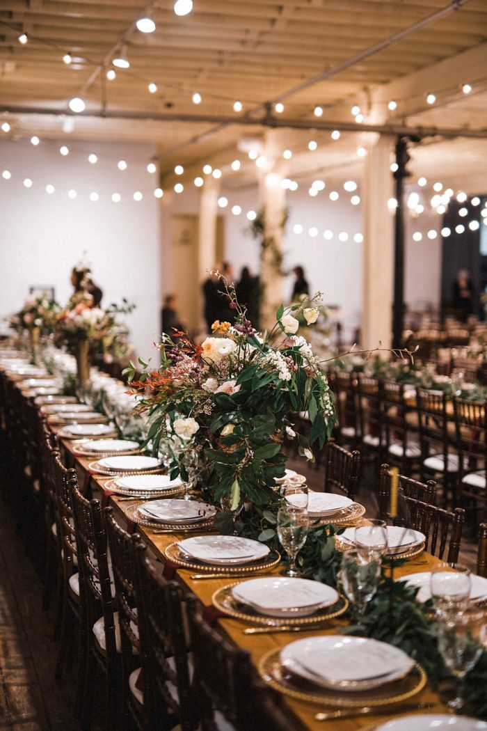 This Vintage Industrial New Year S Eve Wedding At Brik Venue Was A Night To Remember Junebug Weddings Industrial Wedding Table Decorations New Years Wedding Table Decorations