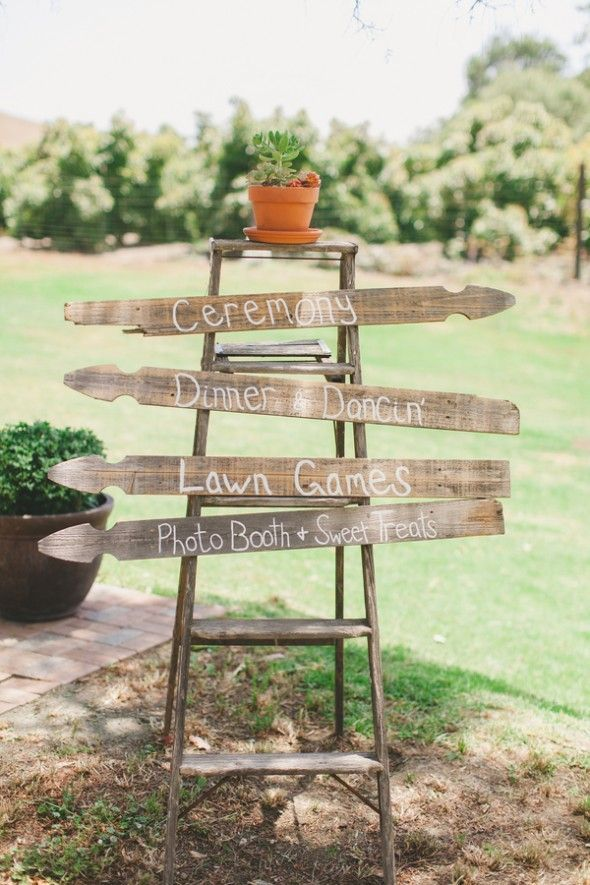 lovely wedding sign with the use of the ladder and fence