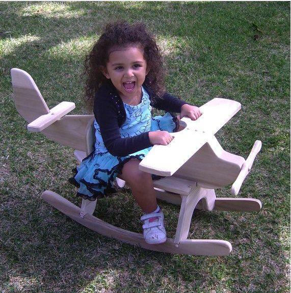 Игрушка-деревянный самолет,кресло качалка.