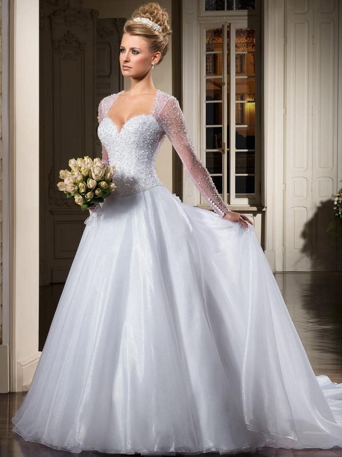 Jaw-dropping gorgeous!  Perfect princess wedding gown!  And the hair & headpiece she's wearing is just amazing elegant too.  Gorgeous for a classic princess wedding.