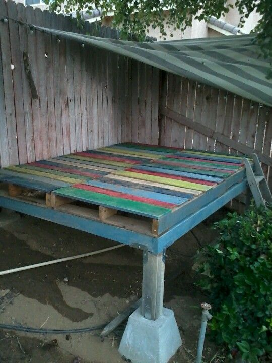 Boys new playhouse ........4 pallets , 4 suports,a handful of 2x4 and leftover house paint.