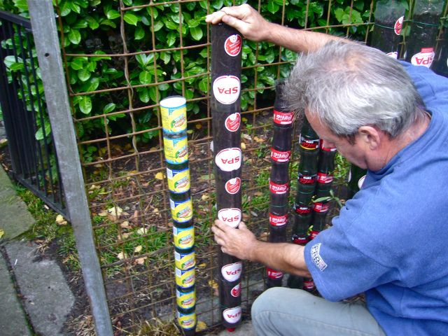 space saving water conserving garden from bottles. How to here:http://www.wikihow.com/Build-a-Vertical-Garden-from-Soda-Bottles