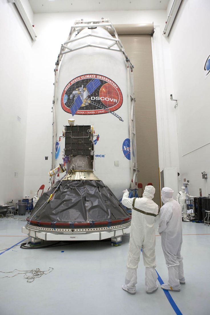 The Deep Space Climate Observatory is pictured inside the Astrotech satellite processing facility in Titusville, Florida. One half of the Falcon 9 rocket's payload fairing is seen behind the spacecraft. Credit: NOAA