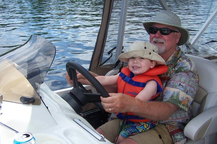 """This photo helps to capture what retirement looks like. Grandson and I are driving the pontoon boat!"" - Norm"