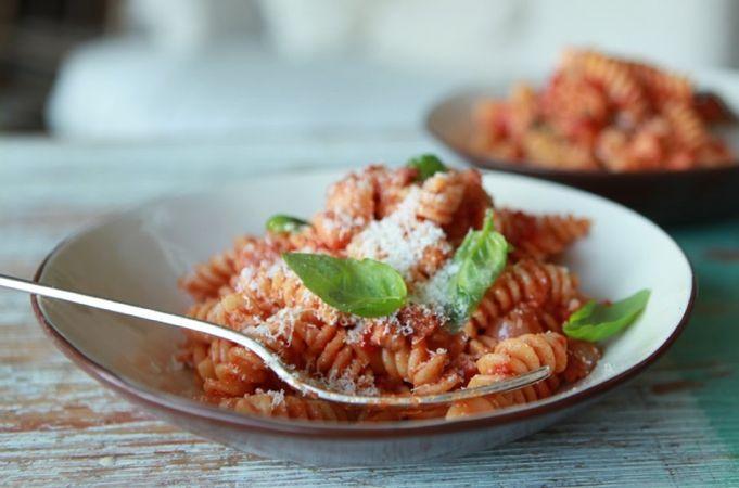 Baked pasta with tomatoes and mozzarella (Pasta al forno con pomodori e…