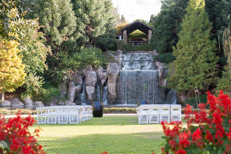 The Sunken Garden at the Hunter Valley Gardens. A garden wedding with waterfall backdrop. Unique wedding location.