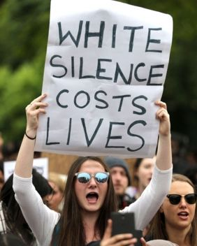 The white feelings called into question by that protest sign aren't just the anger and alienation of Trump supporters. They are also the fear and guilt and perceived helplessness of white people who want to end the epidemic of state-sanctioned violence against black Americans.