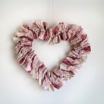 Heart-shaped wreath in gorgeous soft pink and beige tones made by 1000 Pretty Things