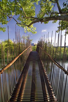 Beautiful arched pedestrian bridge over Lake Austin, Austin, Texas