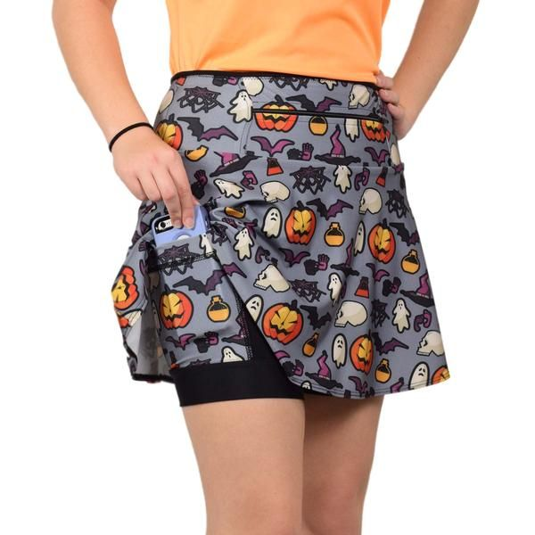 """Swingy Halloween Themed Running Skirt by SparkleSkirts    This comfortable, convenient skirt is also perfect for Trick or Treating in addition to your Halloween runs! Anti-ride shorts, two 6x6"""" leg pockets and a 12"""" zippered waistband."""