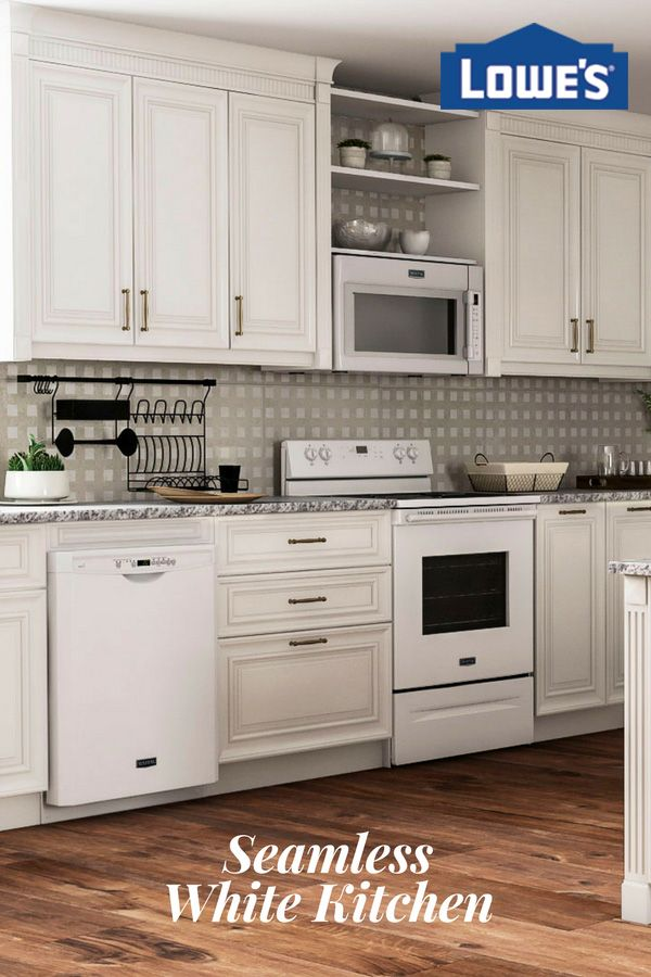 The sleek white Maytag dishwasher and hard food disposer blends naturally with the look and feel of an all-white kitchen design.