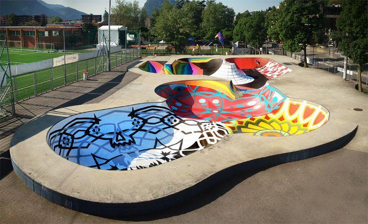 Uma piscina de 1.000 metros quadrados renovada como um skate parque em Lugano, Suíça foi pintado com cores vibrantes e padrões complexos por grupo de arte Zuk Club, baseado em Moscou. Um espectro de cores é caracterizado para o interior da pista, a superfície de skate de em desenhos geométricos e gradiente. Desenhada em uma extremidade da piscina, um arco-íris de cores é em camadas sobre o concreto - o arranjo específico e sua relação com o ambiente em torno dele incorpora um relógio de sol…