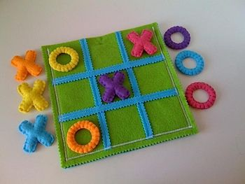This is a tactile version of Tic Tac Toe, complete with a raised grid, plush Xs and Os and braille! The entire game can be stored in the pouch that also serves as the game board. You could even add textures as dots for Braille on the letters #SensorySun