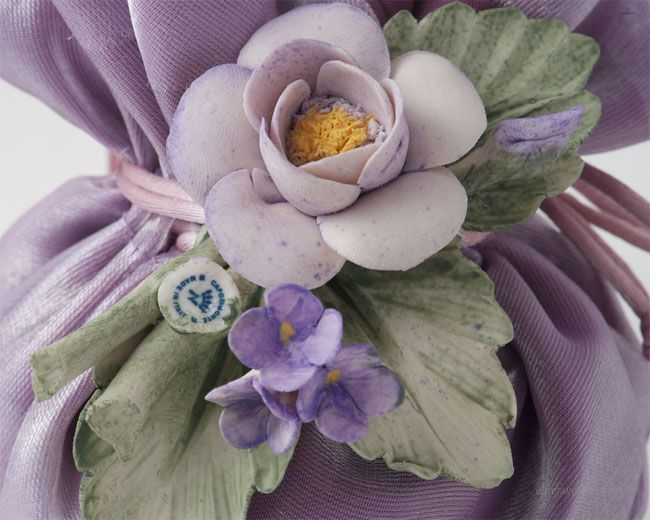 Double layer silk sachet filled with Jordan Almond candies and soft filling, hand made Capodimonte ceramic flower composition