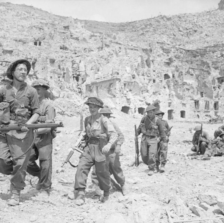 Infantry of the East Surrey Regiment enter the ruins of Cassino, Italy, 18 May 1944