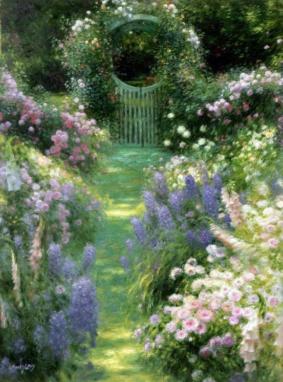 A pretty grass pathway leads to a garden gate. Flowers spill into the pathway and seem to beckon one forth.