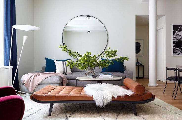 """""""We saw it on the 1stdibs floor and immediately thought, 'That is it!'"""" says designer Brandon Quattrone of the love-at-first-sight reaction he and his business partner Mat Sanders had to the vintage A.R. Cordemeijer daybed that now sits in their client's Tribeca living room. The circle mirror from Consort's showroom is suspended above a Montauk Sofa sectional in the room's corner."""