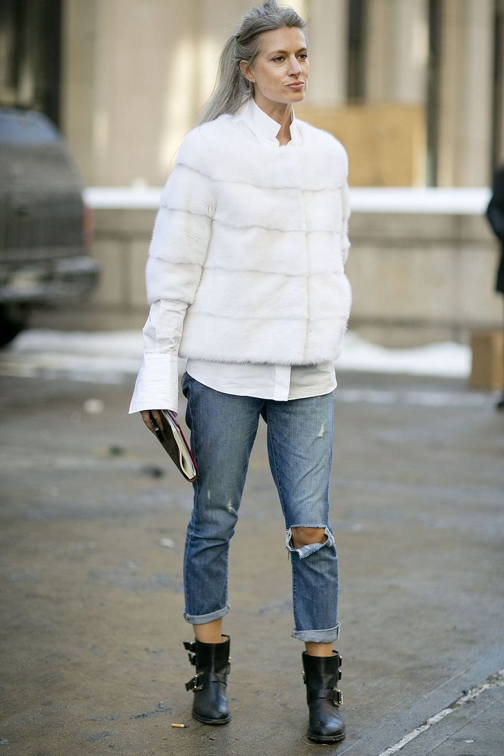 Sarah Harris added polish to boyfriend jeans with a luxe white fur and white button-down.  Source: Tim Regas
