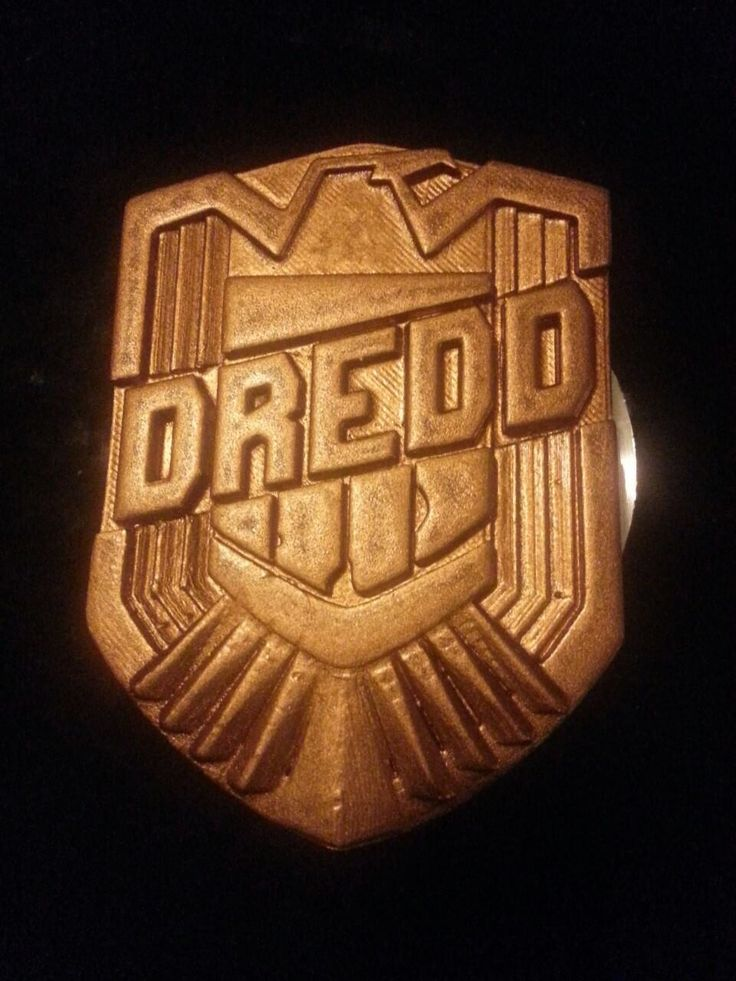 Dredd badge with final paint finish.