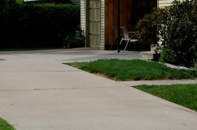 How to Prevent Cracking When Curing Concrete: Concrete surfaces can be valued components of a landscape. Learn how to cure concrete properly.