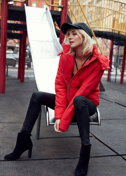 $55 ASOS Bright Red Long Sleeved Puffa Jacket With Black Baseball Cap Dark Grey Back Skinny Denim Jeans And Black High Heeled Boots To Perfect The Spring Time Outfit